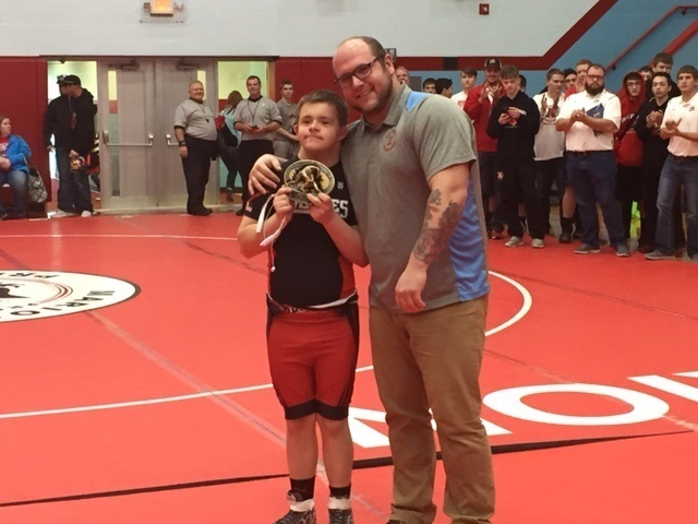 Most Outstanding Wrestler Ryan Drury, Cardington accepting the award from head Coach David Williams